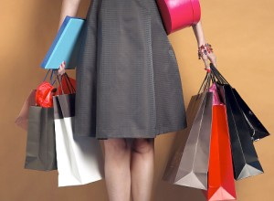 Young woman holding shopping bags and boxes, mid section   Original Filename: 200282976-001.jpg Gettyimages